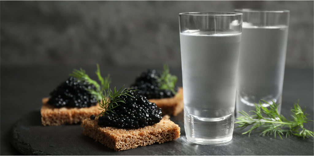 Classic Eastern pairing of herb-infused vodkas with caviar on blini