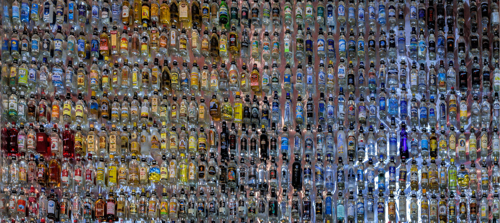 VERKHNIE MANDROGI, RUSSIA - October 03, 2020: Showcase of a gigantic collection of vodka bottles at the Vodka Museum at the Verkhnie Mandrogi craft and museum tourist center. (inset)