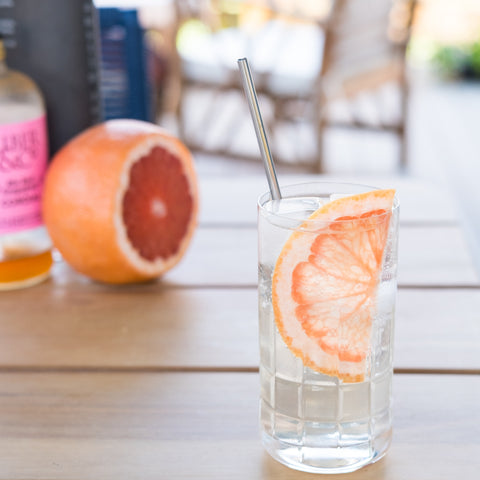 Grapefruit Rickey Cocktail on outdoor table