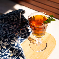 Winter Julep cocktail on table with scarf