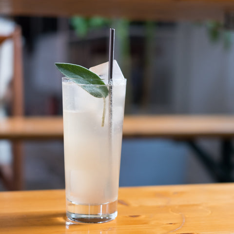 Sage Paloma Cocktail on indoor table