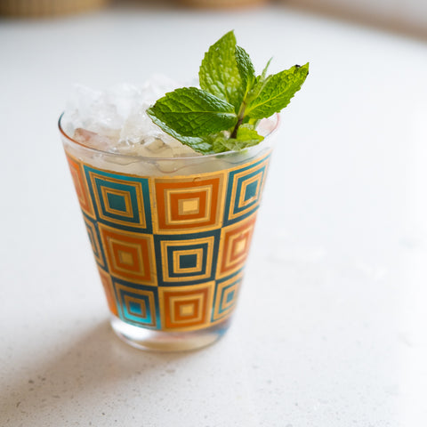 Amande Frappé cocktail on white counter
