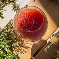 Liber Wassail cocktail on table with wreath