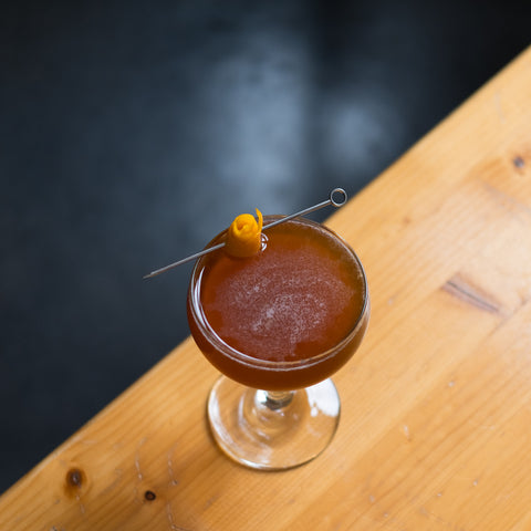 Caramelized Fig Sour on indoor bar