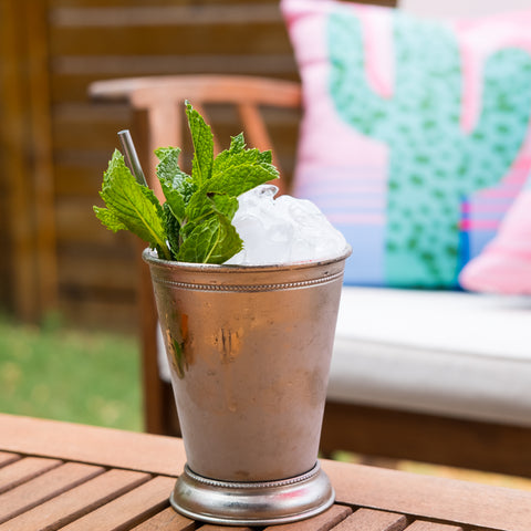 mezcal grapefruit julep on outdoor table