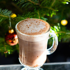 Highland Hot Chocolate in front of Christmas tree