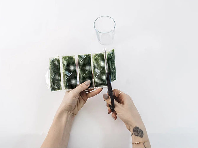 Individual wheatgrass juice being cut off from the rest of the pack