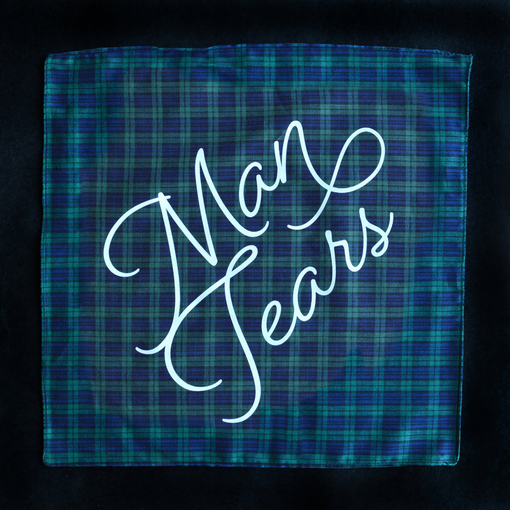 Man Tears Plaid Handkerchief