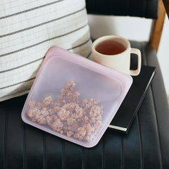 Pink food grade silicone sandwich bag used for snack and food on the go.