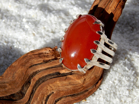 Sterling silver ring set with carnelian, 1 inch long, size 8.