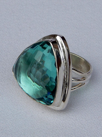 Sterling silver ring set with apatite, vvs rating, size 7.75, 1.25 inches long.