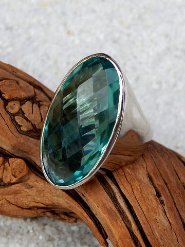 Sterling silver ring set with apatite, vvs rating, size 6.25, 1.25 inches long.