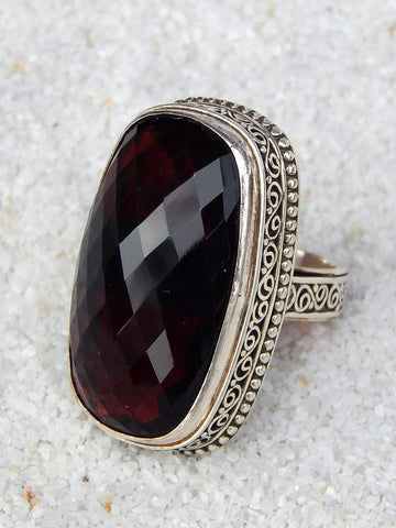 Sterling silver ring set with garnet, vvs rating, size 7.75, 1.5 inches long.