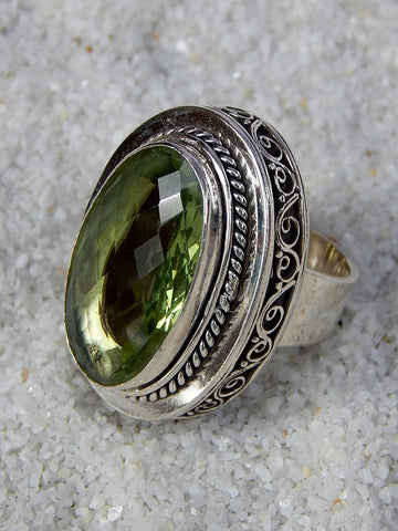 Sterling silver ring set with green amethyst, vvs rating, size 6, 1.25 inches long.