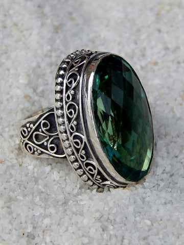 Sterling silver ring set with green tourmaline, vvs rating, size 5.25, 1 inches long.