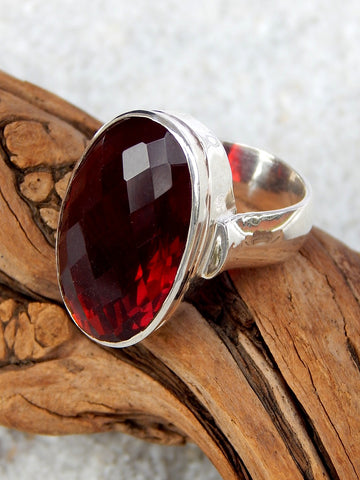 Sterling silver ring set with garnet, size 7.75, 1 inches long.
