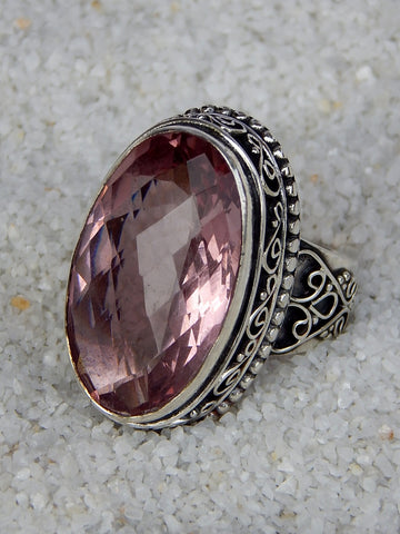 Sterling silver ring set with pink tourmaline, vvs rating, size 6.25, 1.25 inches long.