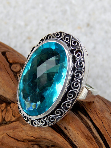 Sterling silver ring set with blue topaz, size 7, 1.25 inches long.