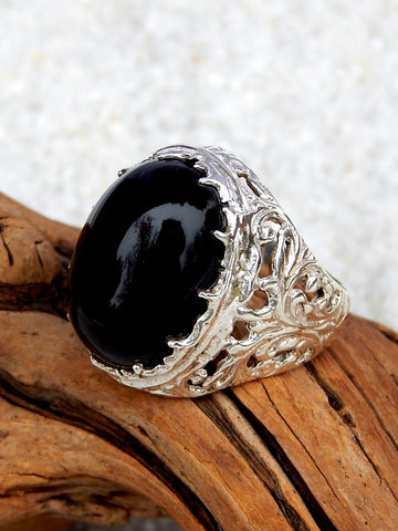Sterling silver ring set with black onyx, size 7.25, 1 inch long.