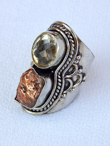 Sterling silver ring set with copper and topaz, size 5.5, 1.5 inches long.