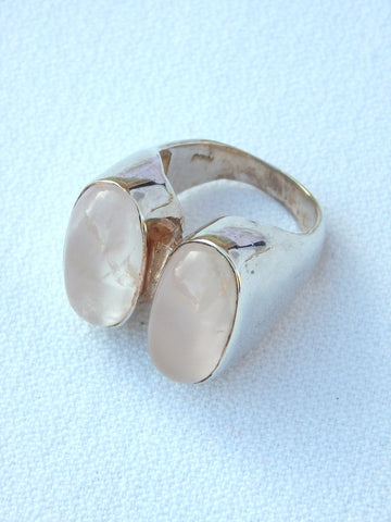 Sterling silver ring set with rose quartz, size 8.25, .75 inches long.