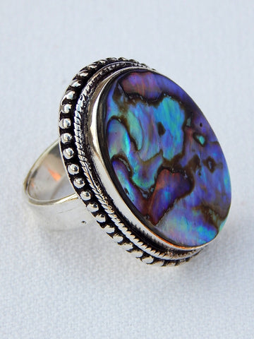 Sterling silver ring set with paua shell from New Zealand, size 6.75, 1.25 inches long.