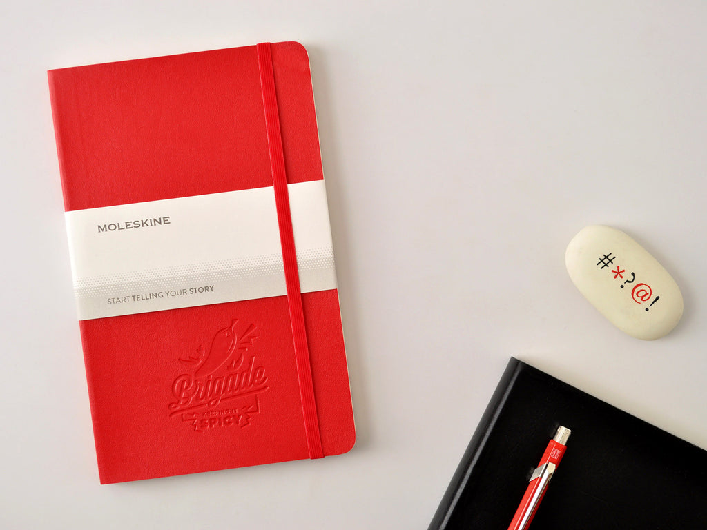 Custom logo embossed Moleskine softcover notebook in scarlet red