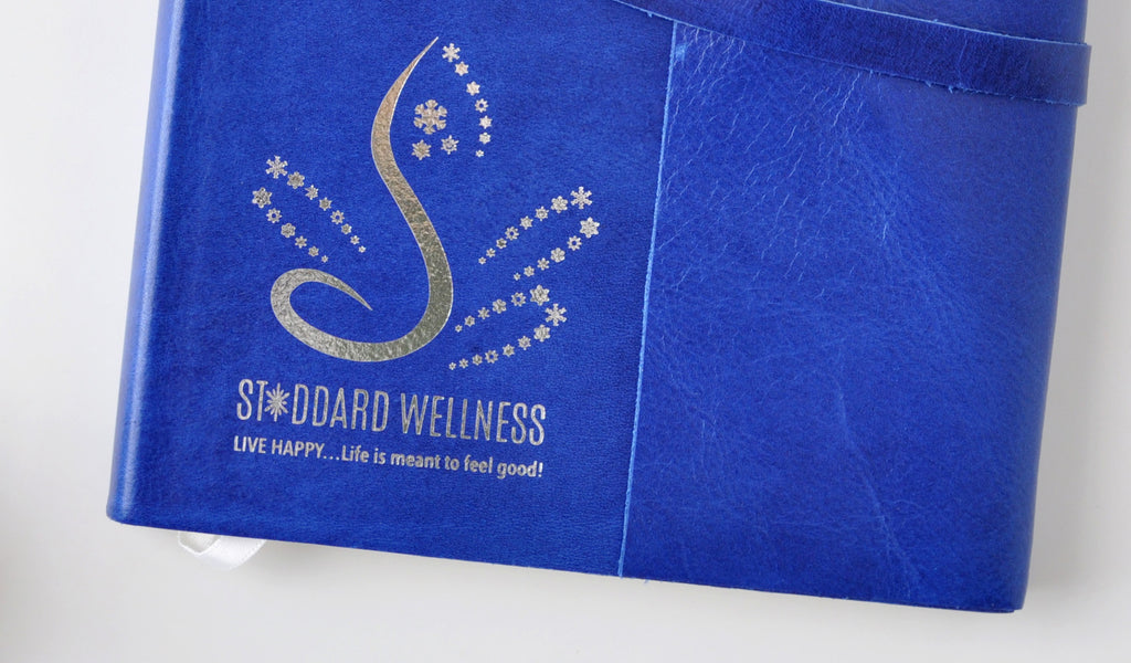 silver foil embossed logo on cobalt blue leather