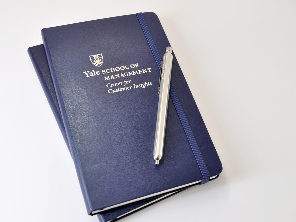 Yale School of Management Center for Customer Insights custom Moleskine notebooks with silver foil logo embossed imprint