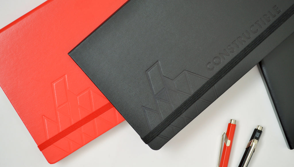 Constructible notebooks with custom embossed logo imprints