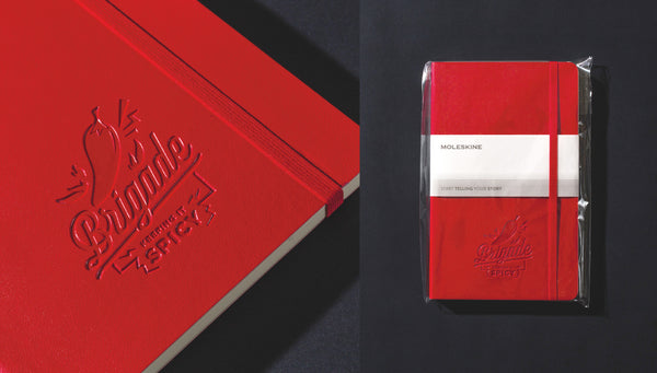 Custom logo embossed Moleskine notebook in red softcover