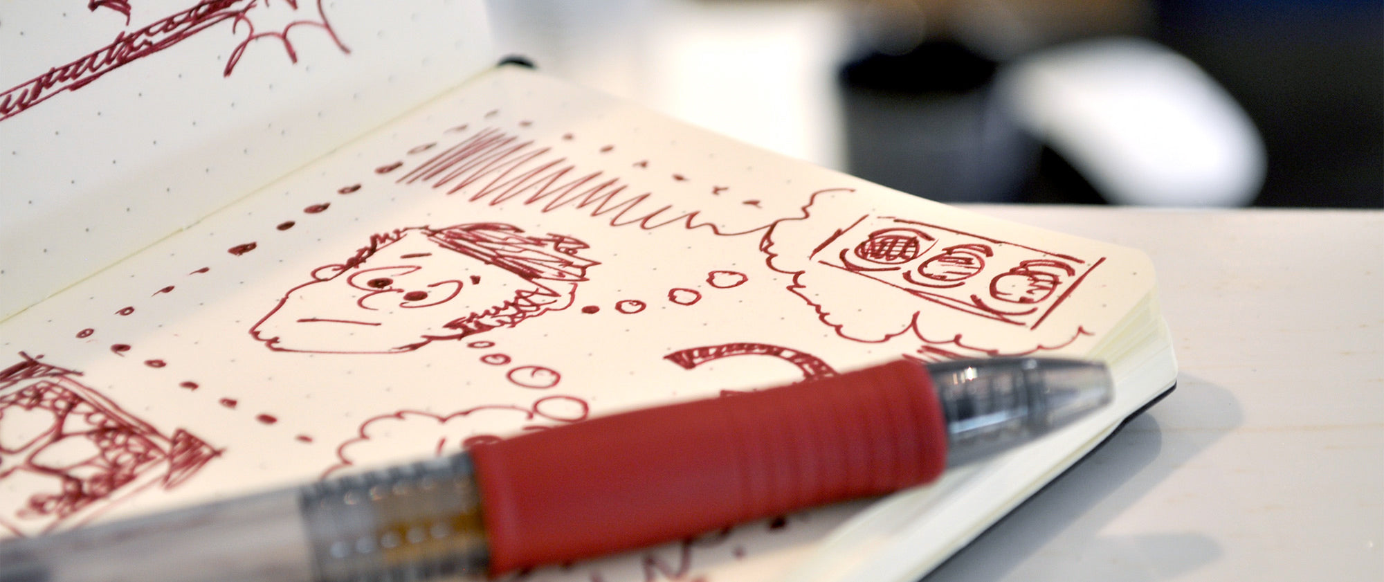 pocket-size notebook with doodling notes