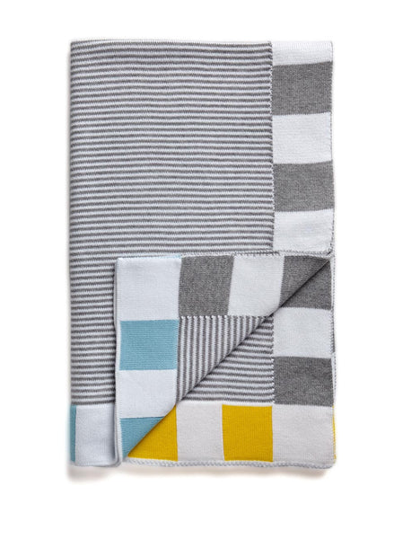 A grey striped baby blanket with a block trim of yellow and blue, Made in Australia