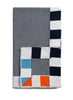 A striped navy Baby Blanket by Sunday Ganim, featuring a bold block trim of baby blue and orange squares.