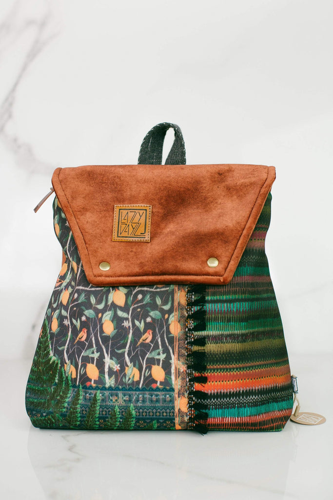 Mini backpack Karpathian brown *vegan, handmade small bag in a pecan velvet colored cup and beautiful patterned designs on the front in a multitude of colors and prints such as flowers, various leaves and colorful threads, grey cloth straps