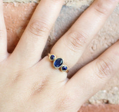 Pre-Loved Three Stone Bezel Sapphire Ring in Yellow Gold