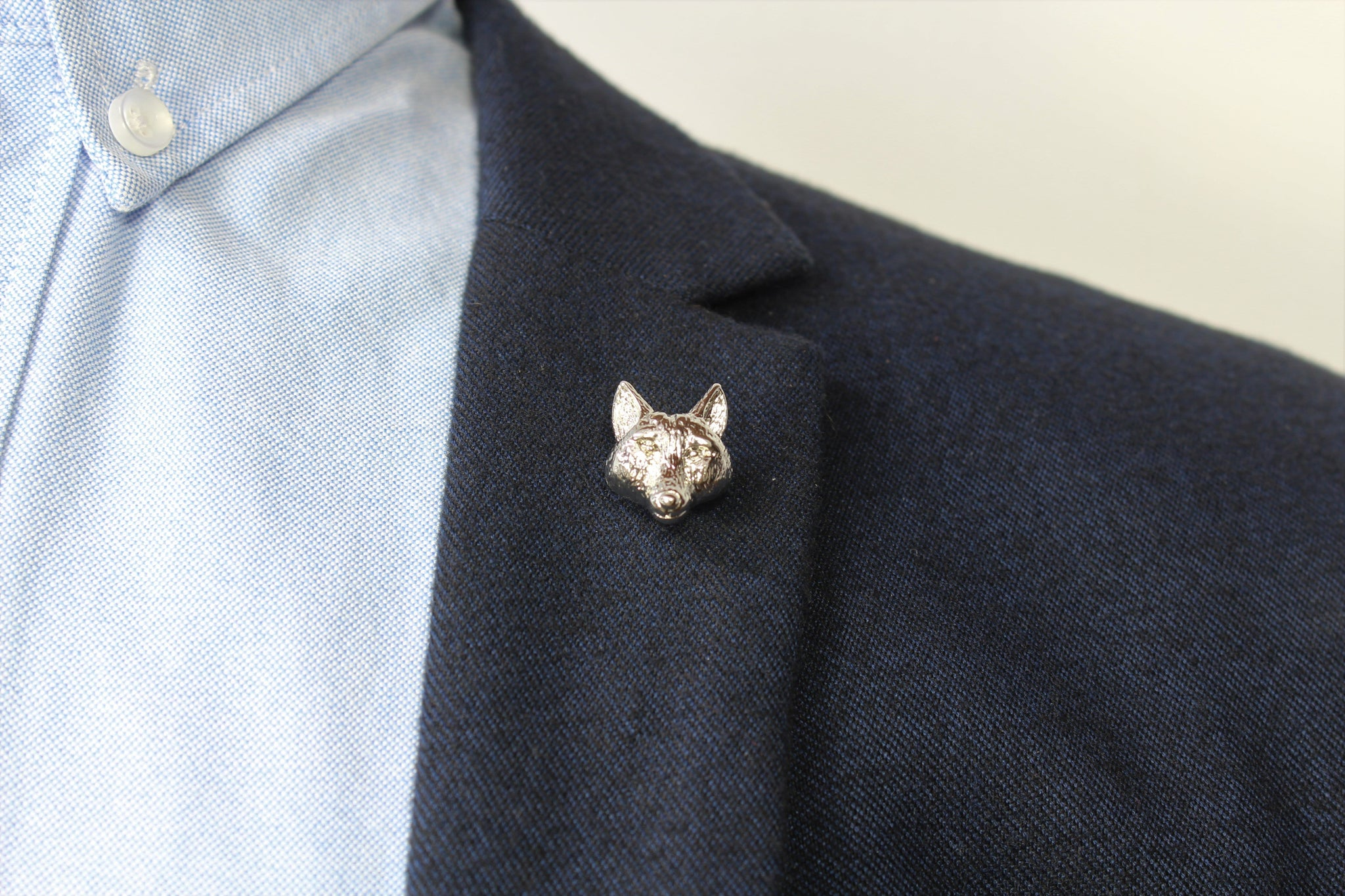Wolf Head Lapel Pin on blazer - Stolen Riches