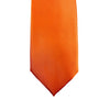 A solid orange microfiber tie. Best paired with a blue dress shirt and brown dress shoes. Great for wedding suits.