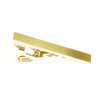 A clasic, brushed gold tie bar by Knotz.