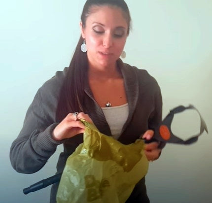 Courtney demonstrates how to load a dootie bag onto a gogo stik pooper scooper