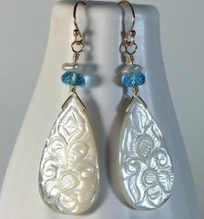Swiss blue topaz & carved mother of pearl drop earrings in gold