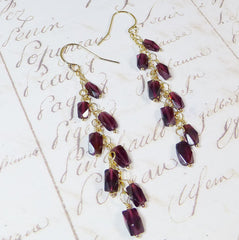 Long  gold gypsy garnet earrings.