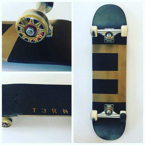 Ternion - Black Ternion in Gold Complete skateboard - California Roller Skates