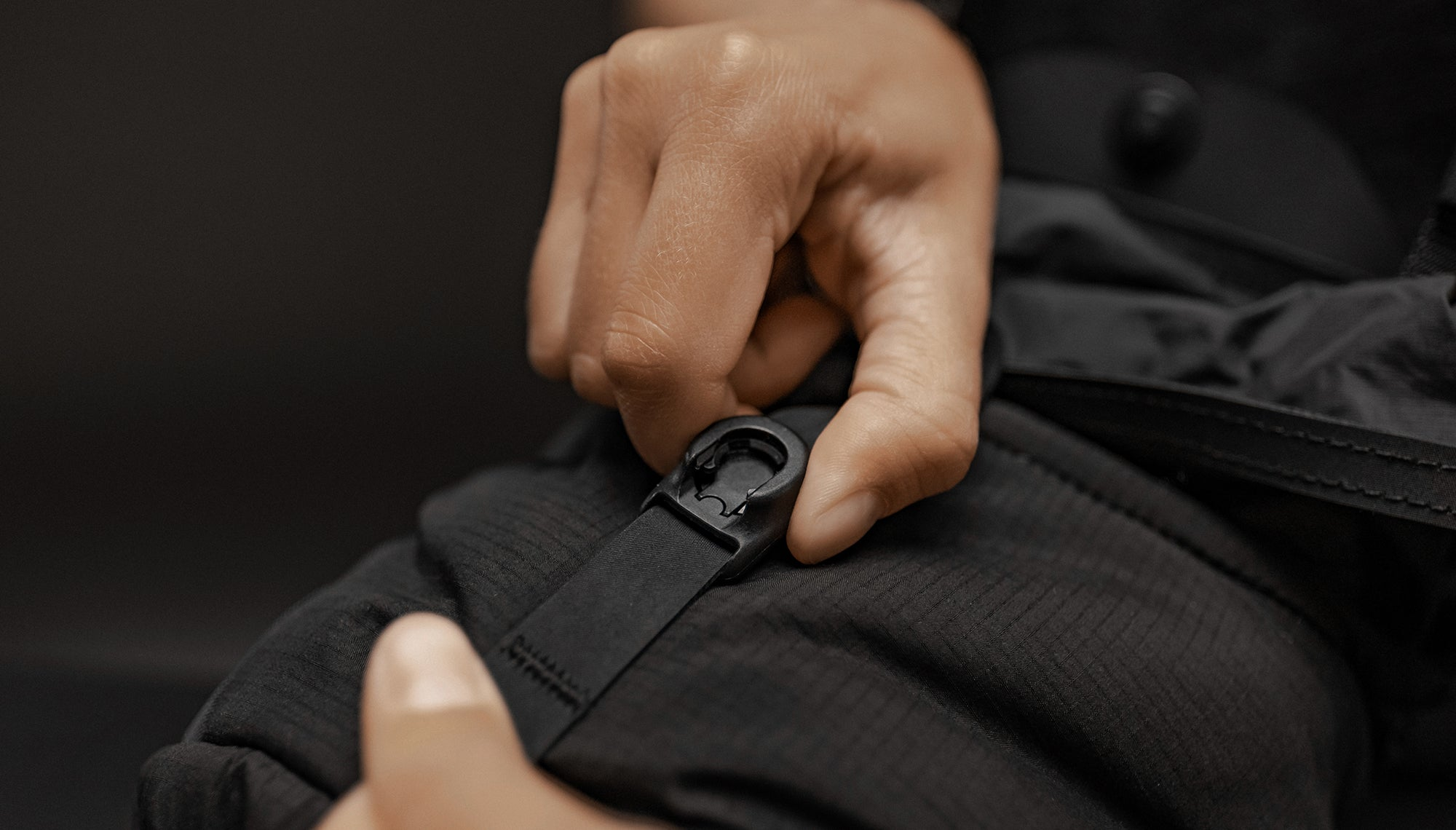 Close up view of hands holding the magnetic latch closure