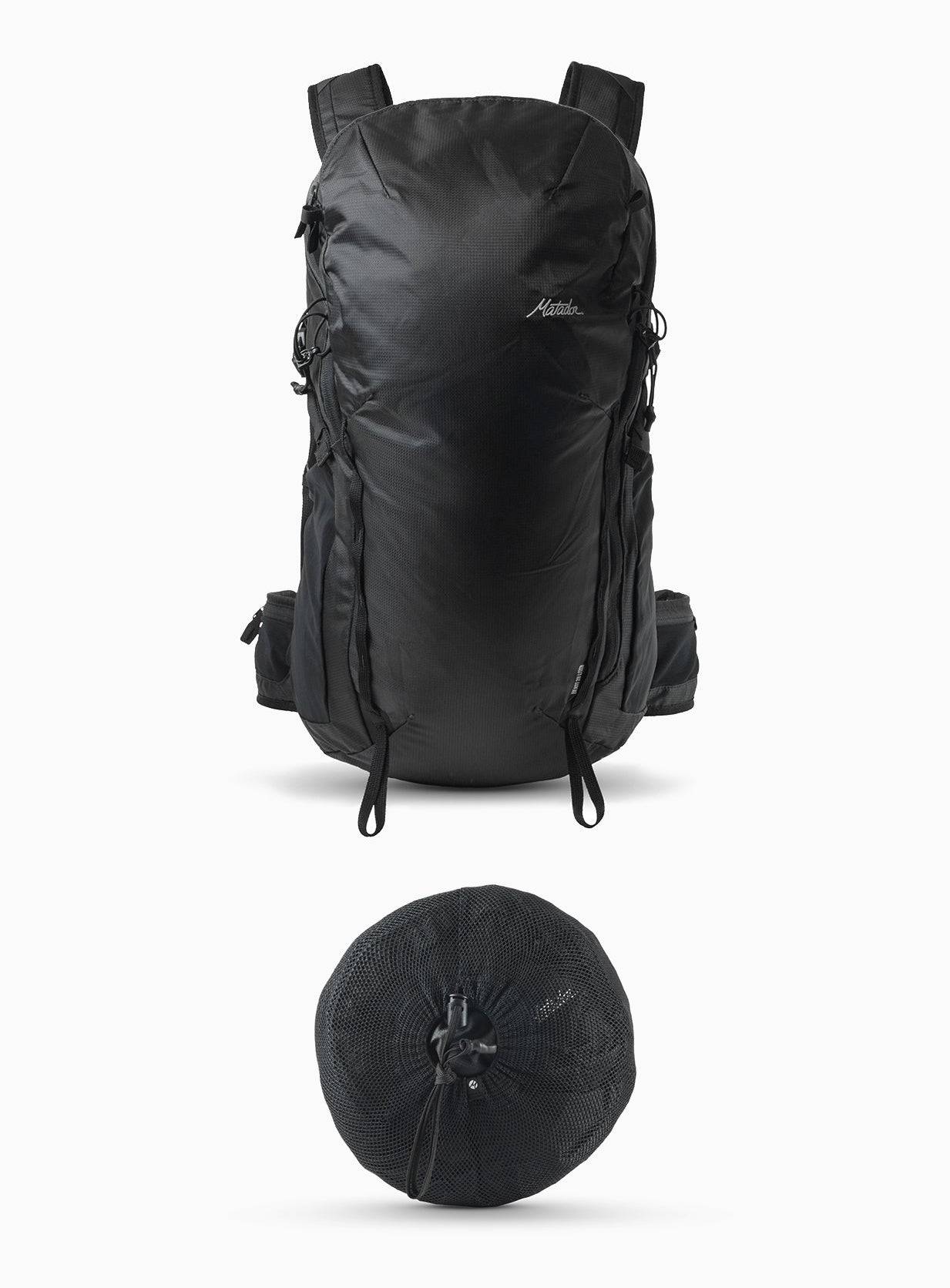 Backpack and packed down pouch on white background