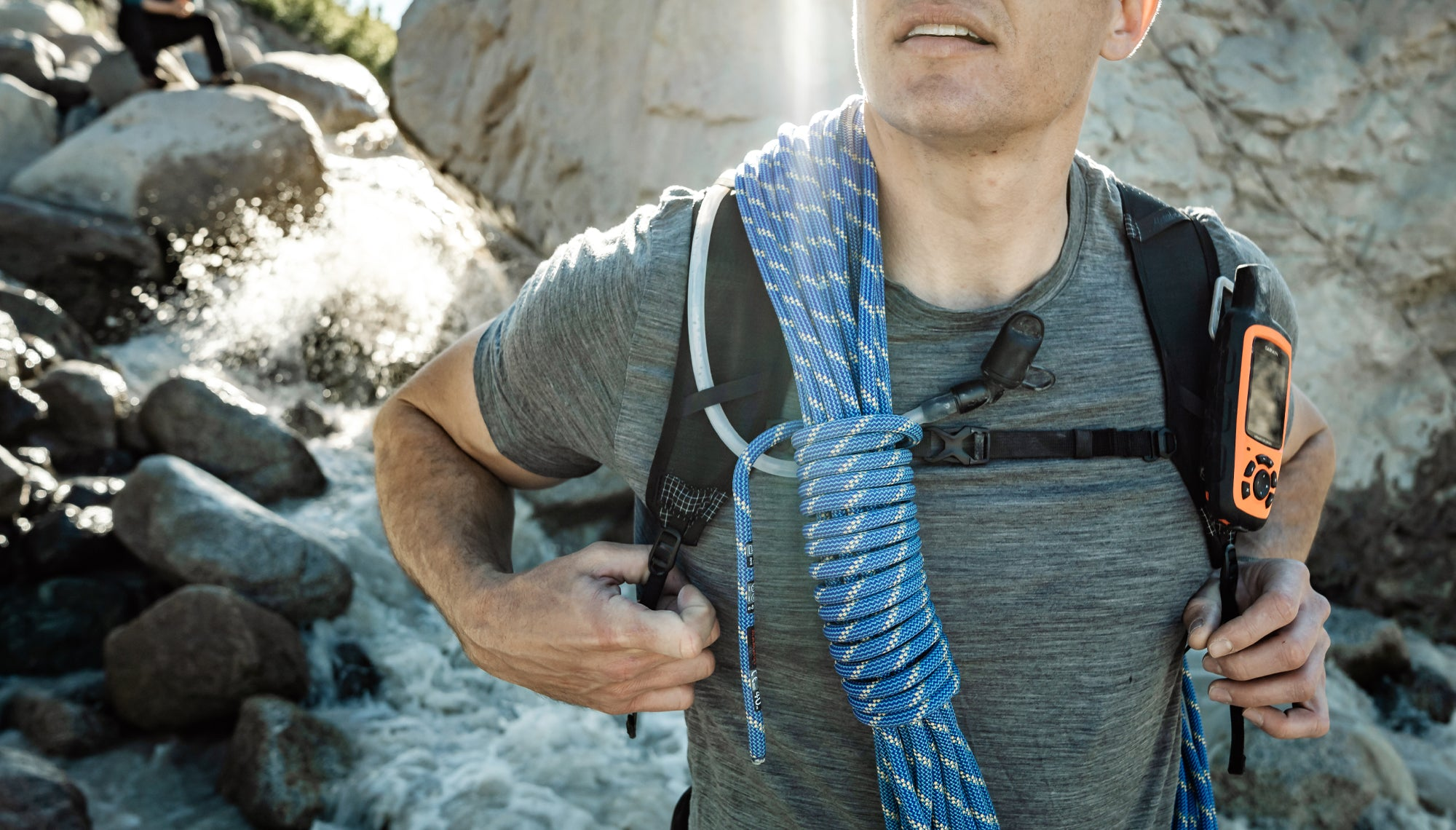Close up view of backpack sternum strap on man outdoors