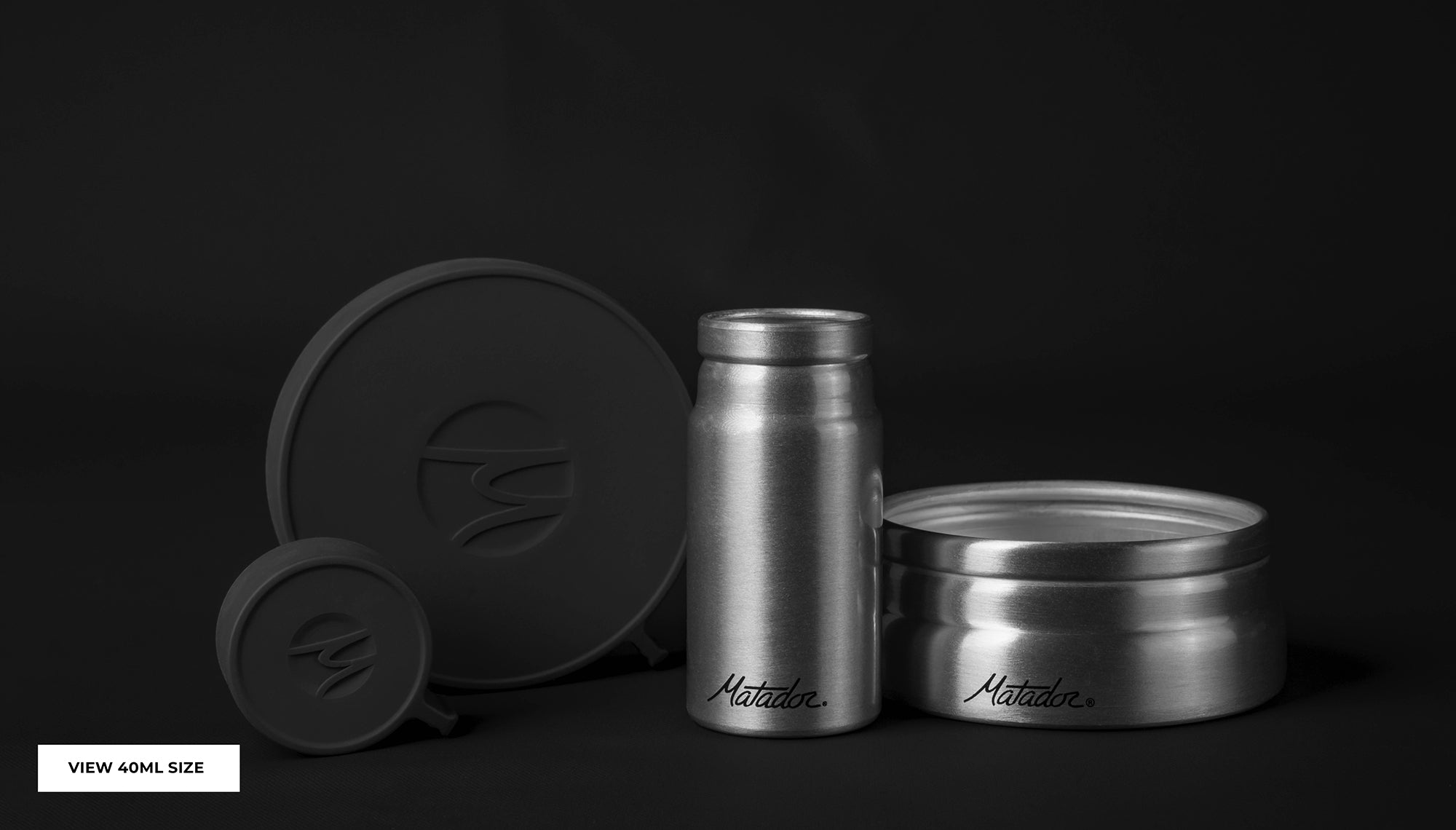 Large and small canister side by side on black background