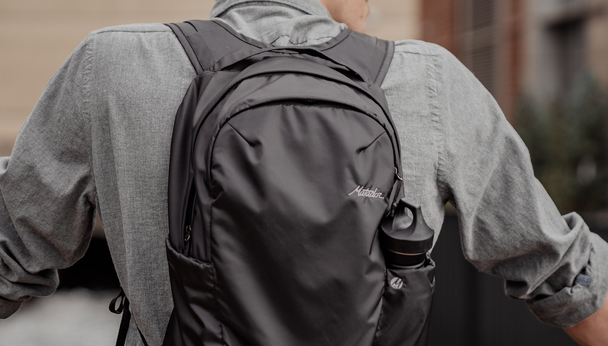 Close up view of backpack on man's back