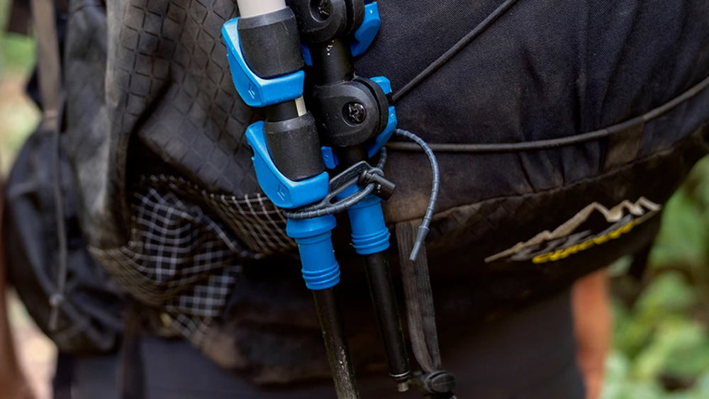 Re-ties attaching hiking poles to backpack