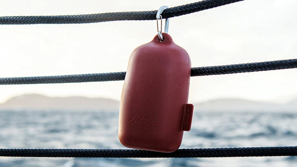 Red nanodry case hanging from boat railing
